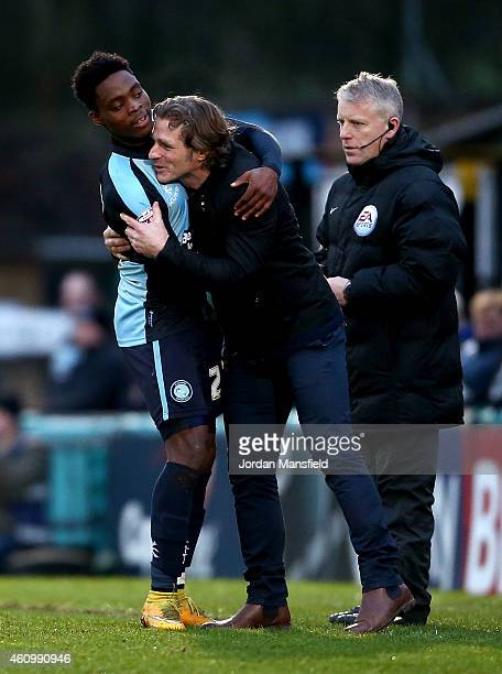 Wycombe manager Gareth Ainsworth congratulates Fred Onyedinma of Wycombe after he scored to make it 10 during the Sky Bet League Two match between...