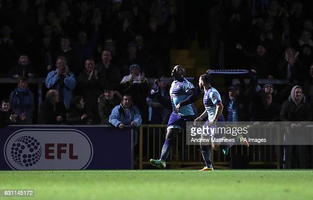 Wycombe Wanderers' Adebayo Akinfenwa celebrates scoring his side's second goal of the game during the Emirates FA Cup Third Round match at Adams Park...