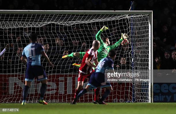 Wycombe Wanderers' Adebayo Akinfenwa scores his side's second goal of the game during the Emirates FA Cup Third Round match at Adams Park Wycombe
