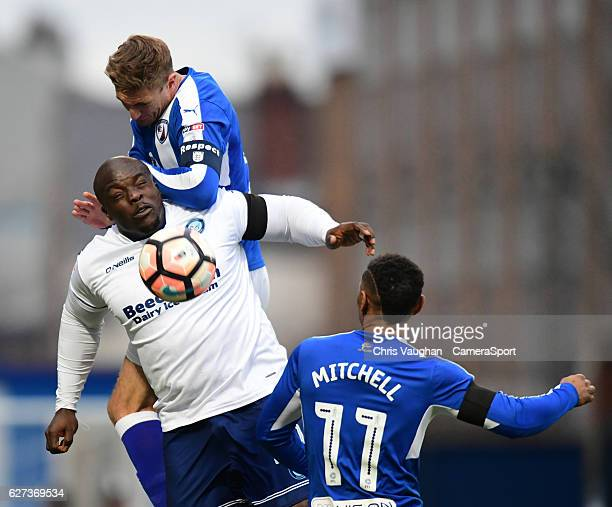 Wycombe Wanderers' Adebayo Akinfenwa vies for possession with Chesterfield's Gary Liddle and Chesterfield's Reece Mitchell during the Emirates FA Cup...
