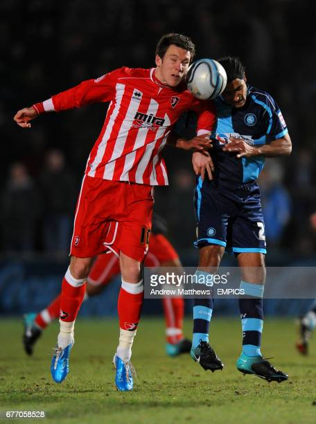 Wycombe Wanderers' Chris Westwood and Cheltenham Town's Jeff Goulding battle for the ball