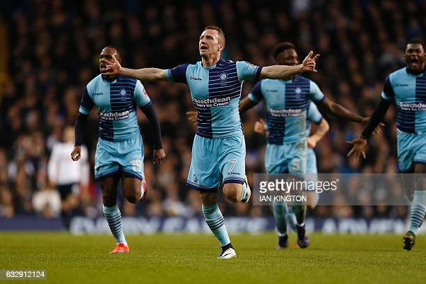 Wycombe Wanderers' English midfielder Garry Thompson celebrates scoring his team's third goal during the English FA Cup fourth round football match...