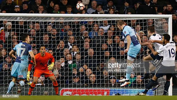 Wycombe Wanderers' English midfielder Garry Thompson heads the ball to scores his team's third goal during the English FA Cup fourth round football...