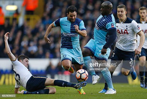Wycombe Wanderers' English striker Adebayo Akinfenwa vies with Tottenham Hotspur's Welsh defender Ben Davies during the English FA Cup fourth round...