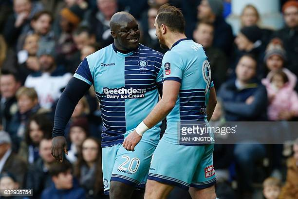 Wycombe Wanderers' English striker Paul Hayes celebrates scoring his team's first goal with Wycombe Wanderers' English striker Adebayo Akinfenwa...