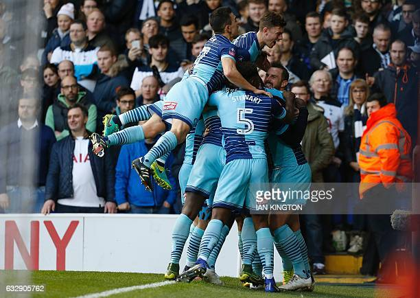 Wycombe Wanderers' English striker Paul Hayes celebrates scoring his team's first goal with teammates during the English FA Cup fourth round football...