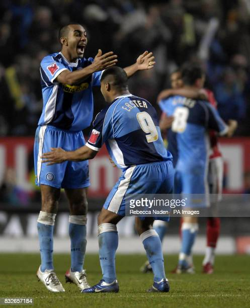Wycombe Wanderers' Jermaine Easter celebrates with Kevin Betsy following their 10 win over Charlton in the Carling Cup QuarterFinal match at the...
