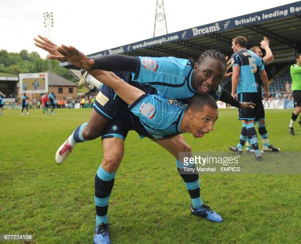 Wycombe Wanderers' Lewis Montrose and JonPaul Pittman celebrate their promotion at the end of the match