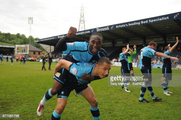 Wycombe Wanderers' Lewis Montrose and Paul Pittman celebrate promotion after the final whistle