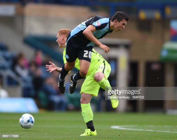 Wycombe Wanderers' Luke O'Nein and Hartlepool United's Michael Woods battle