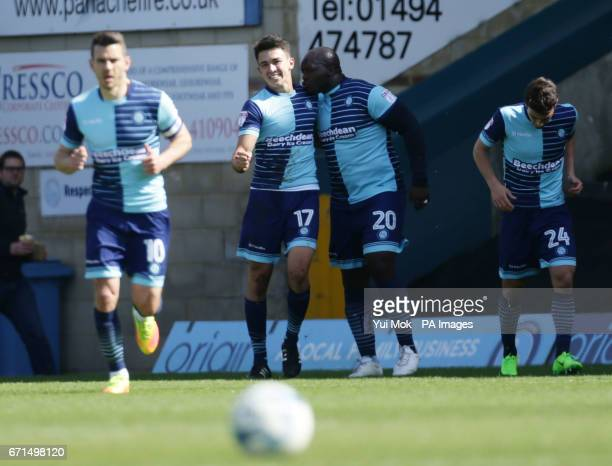 Wycombe Wanderers' Luke O'Nien celebrates with teammate Adebayo Akinfenwa after scoring during the Sky Bet League Two match at Adams Park Wycombe