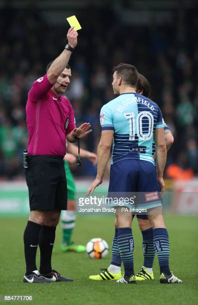 Wycombe Wanderers' Matt Bloomfield is shown the yellow card during the Emirates FA Cup second round match at Adams Park Wycombe