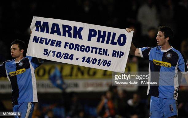Wycombe Wanderers' Russell Martin and Mike Williamson hold a banner in rememberance of Mark Philo after the Carling Cup semifinal first leg match...