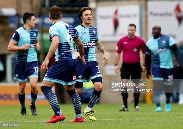 Wycombe Wanderers' Sam Saunders is congratulated by team mate Adam ElAbd after scoring his side's first goal during the Emirates FA Cup second round...