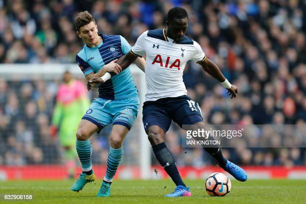 Wycombe Wanderers'English midfielder Dominic Gape vies with Tottenham Hotspur's French midfielder Moussa Sissoko during the English FA Cup fourth...