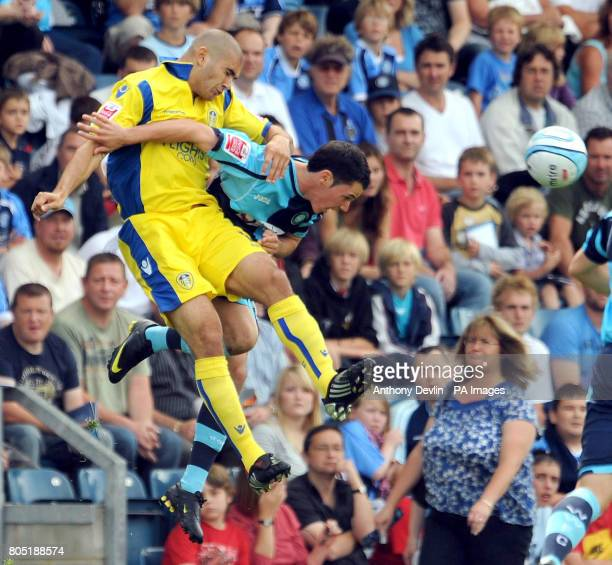Wycombe's Adam Smith and Leed's Bradley Johnson compete for a header during the CocaCola League One match at Adams Park High Wycombe