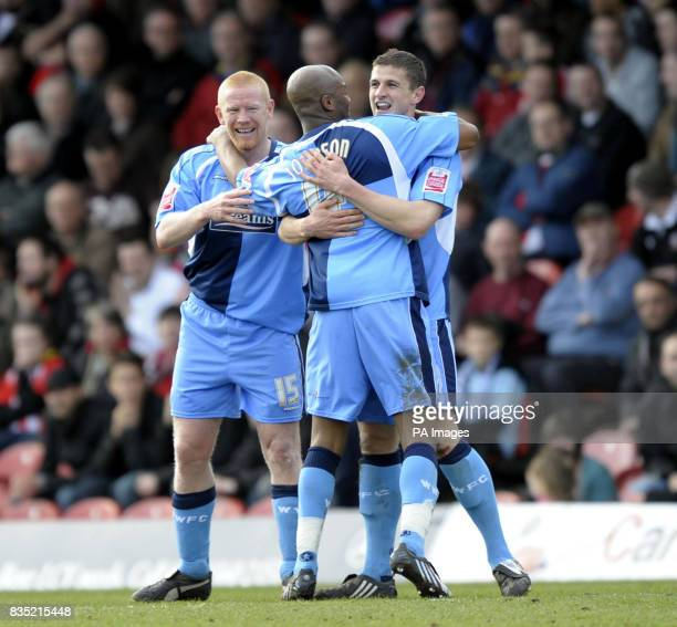 Wycombe's John Mousinho celebrates scoring with Gary Holt and Leon Johnson during the CocaCola League Two match at Griffin Park Brentford