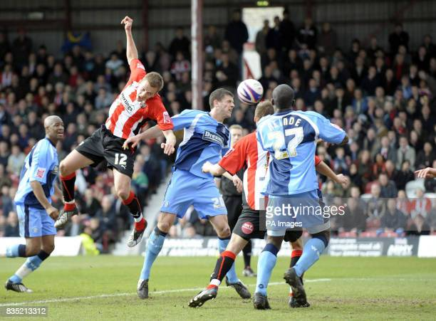 Wycombe's John Mousinho scores his sides second goal during the CocaCola League Two match at Griffin Park Brentford