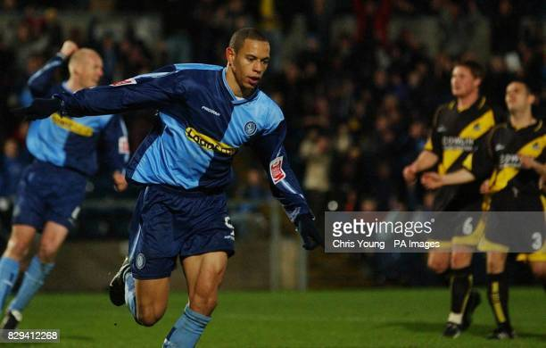 Wycombe's Nathan Tyson wheels away after scoring the winner against Bristol Rovers from the penalty spot in the CocaCola League Two match at The...