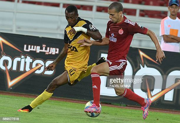 Wydad Athletic Club's Abdellatif Noussir vies for the ball with Asec Mimosas Club's Krahire Yannik Zakri during the 20th edition of CAF Champion...