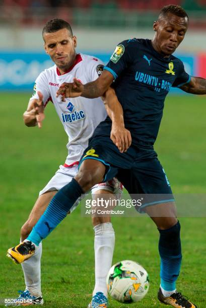 Wydad Athletic Club's Abdellatif Nousssir vies for the ball with Mamelodi Sundowns's Krahire Zakri during the CAF Champions League quarterfinal match...