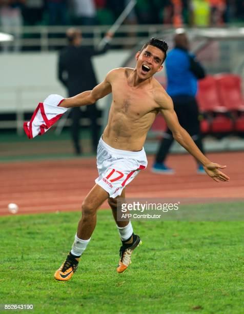Wydad Athletic Club's Achraf Bencharki celebrates vitory over Mamelodi Sundowns following the CAF Champions League quarterfinal match between...