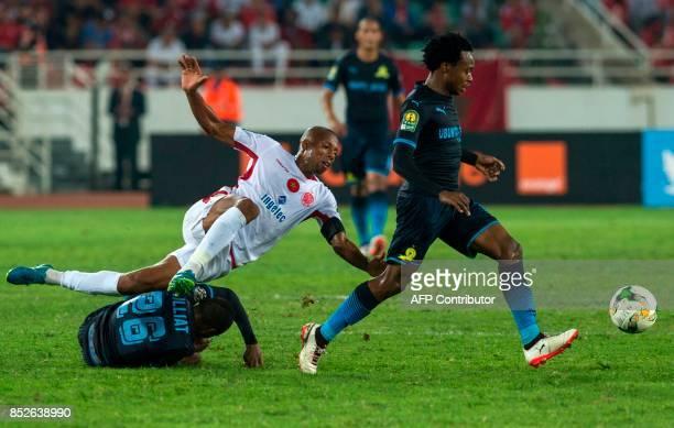 Wydad Athletic Club's Achraf Bencharki vies for the ball with Mamelodi Sundowns's Samuel Tiyani Mabunda during the CAF Champions League quarterfinals...