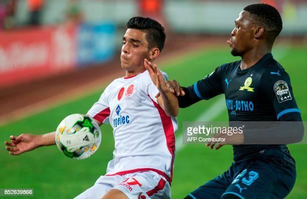 Wydad Athletic Club's Achraf Bencharki vises for the ball with Mamelodi Sundowns's Mot Jeka Madisha during the CAF Champions League quarterfinal...