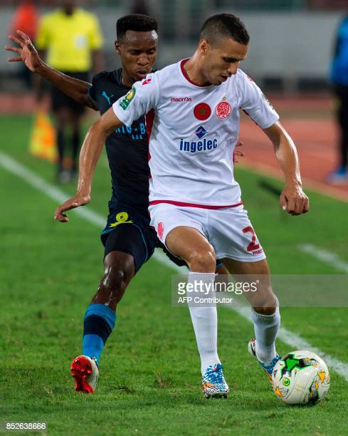 Wydad Athletic Club's Anas al Bashi vies for the ball with Mamelodi Sundowns's Oupa Matthwes Manyisa during their CAF Champions League quarterfinals...