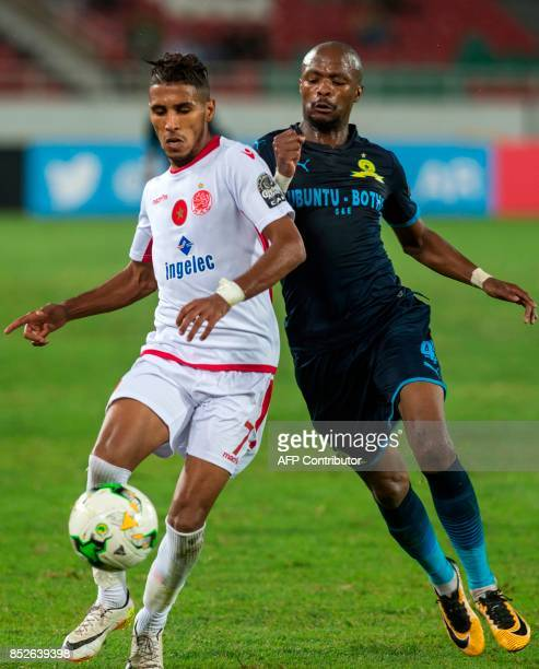 Wydad Athletic Club's Mohammed Ounnajem vises for the ball with Mamelodie Sundowns's Tebogo Joseph Langerman during their CAF Champions League...