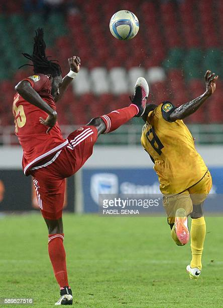 Wydad Athletic Club's Serigne Mourtada Fall vies for the ball with Asec Mimosas Club's Adama Kangoute during the 20th edition of CAF Champion League...