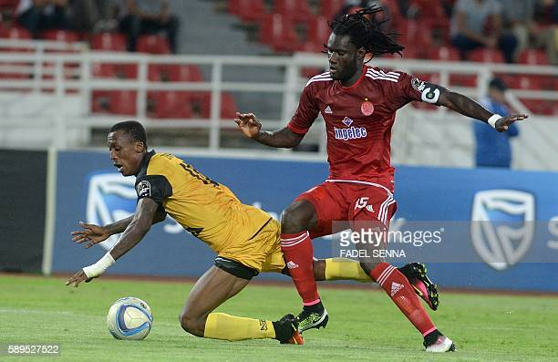 Wydad Athletic Club's Serigne Mourtada Fall vies for the ball with Asec Mimosas Club's Krahire Yannick Zakri during the 20th edition of CAF Champion...
