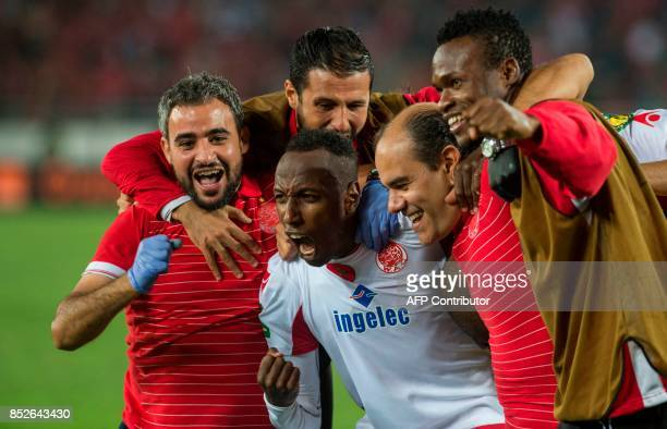 Wydad Athletic Club's team celebrate vitory over Mamelodi Sundowns following the CAF Champions League quarterfinal match between Morocco's Wydad...