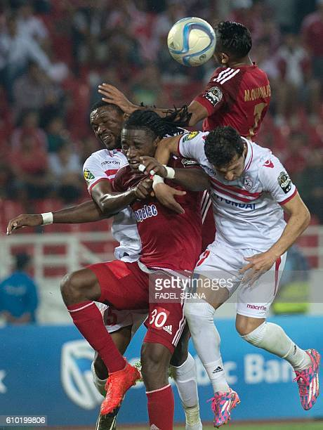 Wydad Athletic Club's William W Jebor vies for the ball during the CAF Champions League semifinal between Wydad Athletic Club and Zamalek Sporting...