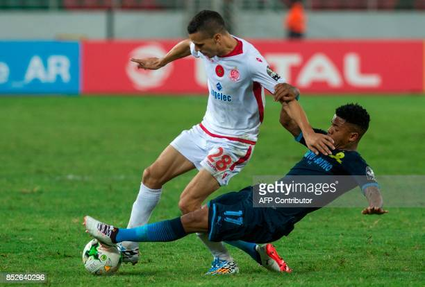 Wydad Athletic Club'sAbdellatif Noussir vies for the ball with Mamelodie Sundowns's George Lebese during the CAF Champions League quarterfinal match...