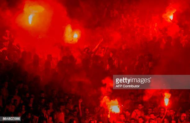 Wydad Casablanca fans celebrate a goal against USM Alger during the CAF Champions league semifinal on October 21 at Mohamed VI stadium in Casablanca...