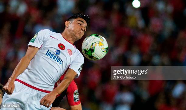 Wydad Casablanca player Achraf Bencharki vies for the ball with the USM Alger's Aberrahmane Meziane during the CAF Campions league semifinal on...