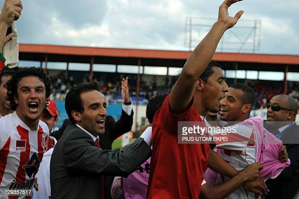 Wydad Casablanca players of Morocco celebrate their qualification after the African Championships League second leg semi final match with Enyimba of...