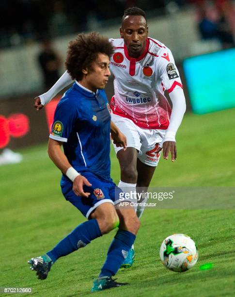 Wydad Casablanca's Abdeladim Khadrouf vies for the ball against AlAhly's Hussein Sayed during the CAF Champions League final football match between...