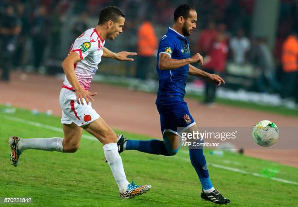Wydad Casablanca's Abdelatif Noussir vies for the ball against AlAhly's Walid Soliman during the CAF Champions League final football match between...