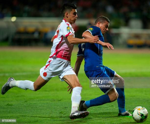 Wydad Casablanca's Achraf Bencharki vies for the ball against AlAhly's Sadelindin Samir Saad Ali during the CAF Champions League final football match...