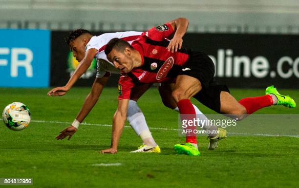 Wydad Casablanca's Badr Gaddarine vies for the ball with the USM Alger's Ayoub abdellaoui during the CAF Campions league semifinal on October 21 at...