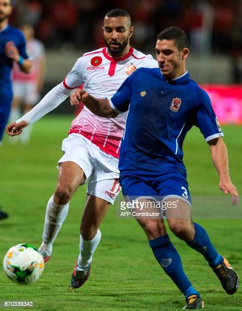 Wydad Casablanca's Ismael El Haddad vies for the ball against AlAhly's Ramy Hisham Abdelaziz Rabia during the CAF Champions League final football...