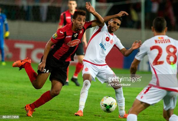 Wydad Casablanca's Mohammed Ounnajem vies for the ball with the USM Alger's Mohamed Benkhemassa during the CAF Campions league semifinal on October...