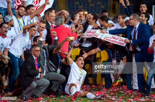 Wydad Casablanca's players celebrate after winning the CAF Champions League final football match between Egypt's AlAhly and Morocco's Wydad...