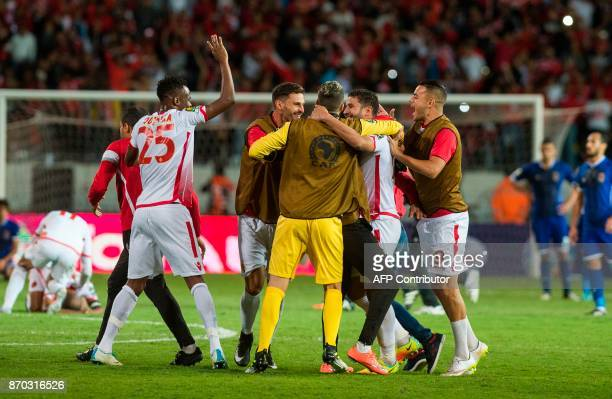 Wydad Casablanca's players celebrate winning the CAF Champions League final football match between Egypt's AlAhly and Morocco's Wydad Casablanca on...