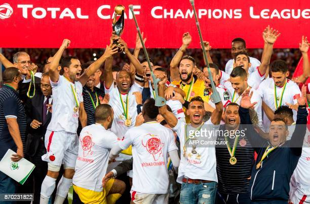 Wydad Casablanca's players celebrate with their trophy after winning the CAF Champions League final football match between Egypt's AlAhly and...