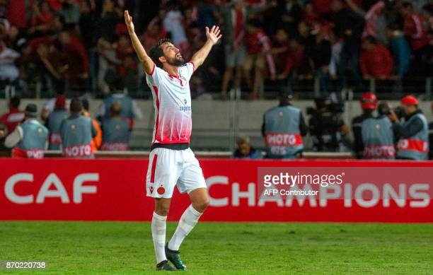 Wydad Casablanca's Salaheddine Saidi celebrates after his team scored a goal during the CAF Champions League final football match between Egypt's...