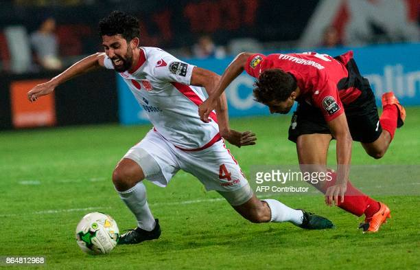 Wydad Casablanca's Salaheddine Saidi vies for the ball with the USM Alger's Mohamed Benkhemassa during the CAF Campions league semifinal on October...