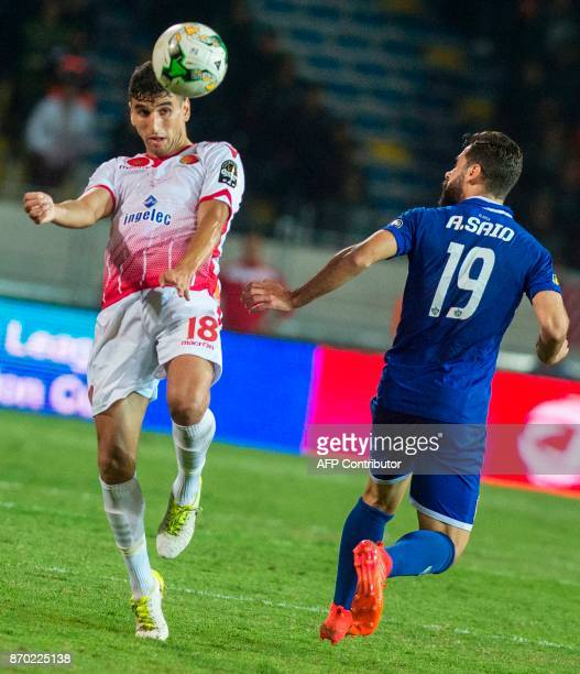 Wydad Casablanca's Walid alKarti vies for the ball against AlAhly's Abdallah Said during the CAF Champions League final football match between...